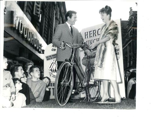 Liberace presents a bike.
