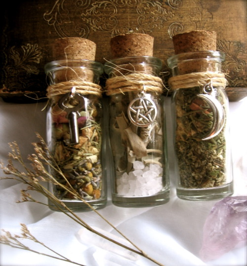 eirecrescent:  3 Witchy Herbal Blends: Love, Sacred Space and Prophecy here: http://www.etsy.com/listing/81955137/3-essential-witchy-herbal-blends-love Love Bottle (1.)  Opening your heart so love and happiness may find you:herbs include- lavender, rosebuds, chamomile, jasmine, rosemary.This bottle has a vintage key on the outside symbolizing the ability to unlock your heart so that love may come.Sacred  Space bottle (2.) Cleansing your magical space or protecting your home  from negative energy. Has large sea salt inside (for protective seals/  circles)herbs: SageThis bottle has a Tibetan silver pentacle on the outside. The pentacle represents protection and the Elements.Prophecy and Boosting Psychic Powers (3.) This blend helps bring on prophecies and amplify ones psychic abilities.Herbs: Mugwort, Cinnamon, Star anise, Peppermint, RosemaryThis  bottle has a Tibetan silver crescent moon charm! The moon represents  magic and mystery and the sacred feminine. When the moon is waxing overhead  it is a perfect time for divination and scrying.