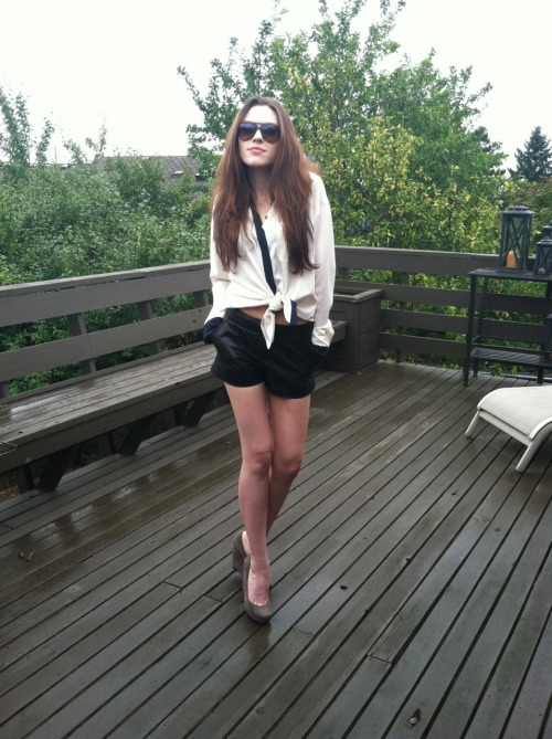 "Look of the Day - Leather and Menswear Part Duex Trouve' leather shorts, Thoery blouse, Dolce Vita Wedges and Ray Ban aviators.  I've been saying to my best friend Allie that I wanted a shirt that looked like I just slept with a high power business man and then stole one of his shirts. This is that shirt, I like to think of it as ""walk of shame chic""."
