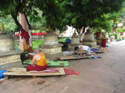 Tibetans Prostrating to the Bodhi Tree They stay in town for months and do this one hundred thousand times.