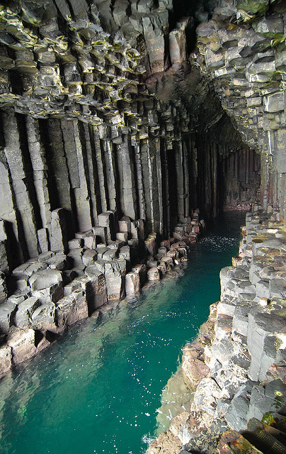 "enchantedengland:     Fingal's Cave is a sea cave on the uninhabited island of Staff, one of the Inner Hebrides islands which skirt the western coast of Scotland. The immense arch-roofed cave creates a melodic, haunting echo of waves within its cathedral-like atmosphere; something so impressive Romantic Poets John Keats, William Wordsworth, and Alfred, Lord Tennyson all made journeys here; as well as Her Majestic Queen Victoria. The cave's Gaelic name is Uamh-Binn, meaning ""cave of melody.""    (image by scuba dooba on flickr)"