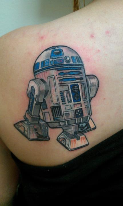 This is my R2D2 tattoo. The reason behind this tattoo is Star Wars was a huge part of my childhood and holds a lot of memories for me. My whole life R2D2 was my favorite character. So when I decided I wanted to get a tattoo the choice was obvious. I knew almost instantly what I wanted. I didn't want him to look cartoonish, but I wanted him to look as real as possible. So I was told by several of my friends that I needed to go to an artist by the name of Robert Hendrickson. So I went to where gallery he was working (The Rouge Elephant Art Gallery, Moreno Valley, California), and told him what I wanted. He said he could do it. I was extremely nervous because although I had completely faith in Rob I was afraid it was not going to be what I wanted but he went above and beyond my vision. I am in love with my tattoo and could not be happier with the results <3
