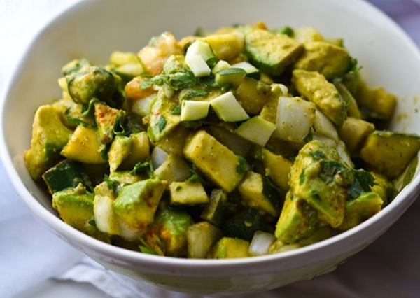 Super Bowl Zucchini Guacamole, by Happy Healthy Life 1 large avocado - about 1 1/2 cups cubes 1 1/2 cups raw zucchini, cubes 1 tbsp olive oil - for quick saute 1/2 tsp pepper 1/2 tsp garlic powder pinch of sea salt to taste 1/2 cup white onion, diced 1/4 cup chopped parsley or cilantro 1/3 cup lemon juice 1 jalapeno, diced - or a few dashes of cayenne (optional) 1. I lightly saute the zucchini cubes in very hot oil for just about 1-2 minutes. Just to caramelize the edges. Salt to taste.2. Toss zucchini with remaining ingredients. Chill. Serve!