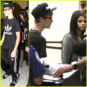 Selena & Justin at airport to Atlanta.