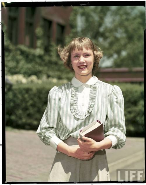 A stylish young lady photographed by Alfred Eisenstaedt at New Trier High School in Winnetka, Illinois in June of 1950.