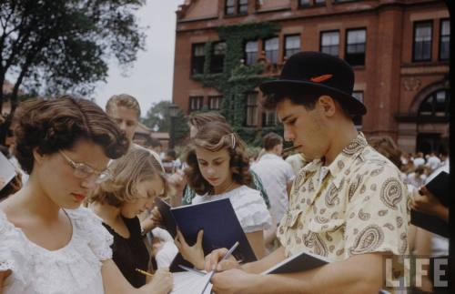 An Alfred Eisenstaedt photo of students signing yearbooks on the last day of school at New Trier High School in Winnetka, Illinois in June 1950. Several girls can be seen wearing the Mexican inspired peasant blouses which were so popular in the late 1940s and early 1950s.