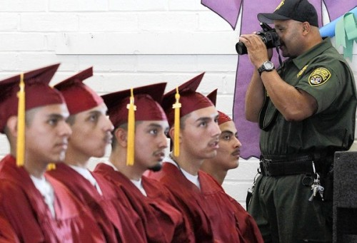 latimes:  Caps and gowns behind locked gates: At a youth correctional facility to be shuttered by budget cuts, a final high school class graduates. Hope for the future mixes with concern about transfers to remaining California facilities. Photo:  A guard snaps pictures of the Class of 2011 of Jack B. Clarke High School, part of a state youth correctional facility in Norwalk that is closing. Credit: Luis Sinco / Los Angeles Times