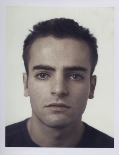 Maxence Villien (2005) Polaroid.  © John L Morrison 5x4 Polaroid study Using a Sinar 5x4 camera has its challenges but I personally loved seeing the world upside-down and back-to-front on the ground glass screen. This fresh perspective, enables a new way of seeing, allowing you to spot patterns invisible to the eye when everything is the right way round.