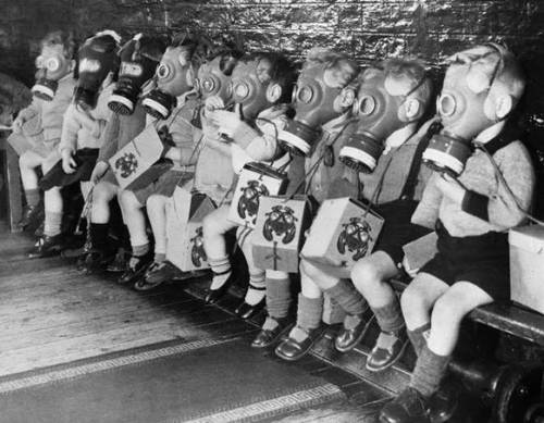 talesofwar:  Kids wearing gas masks.
