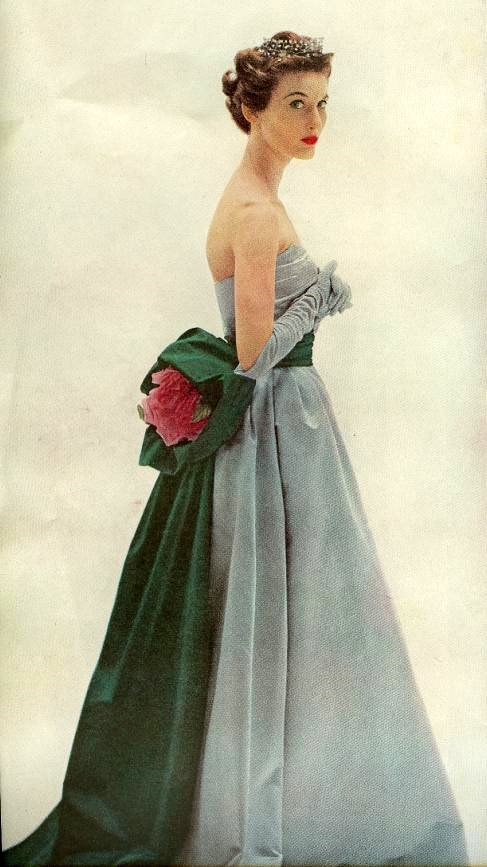 theniftyfifties:  Model in a blue/grey evening gown, 1950s.