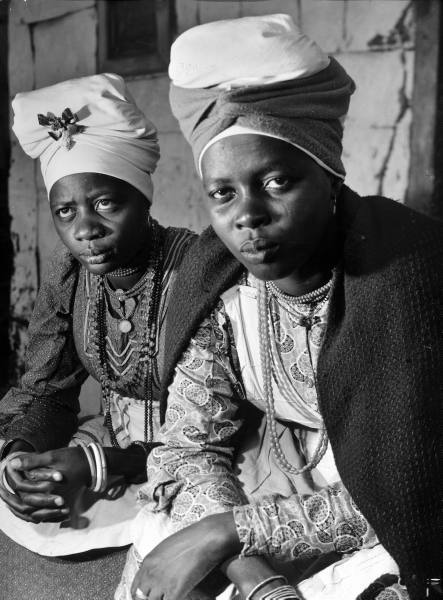 legrandcirque:  Herero women wearing traditional turban which is put on at the age of 18 signifying readiness for marriage. Photograph by Margaret Bourke-White. Windhoek, South Africa, April 1950.
