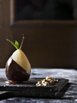 Pear dipped in dark chocolate. Such an elegant dessert and so simple that no recipe is needed.  Recipe link below photo
