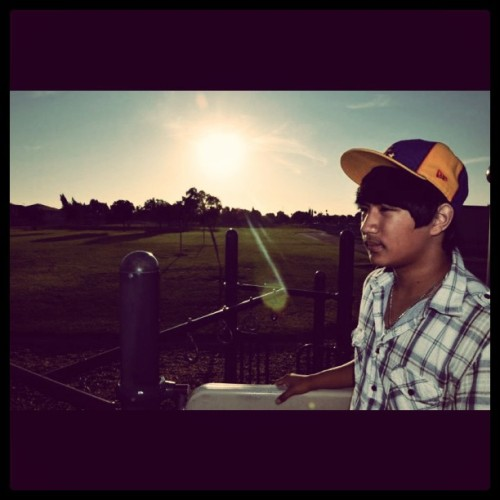 My #nephew. #sun #sunset #nikon #d7000 #hat #cap #newera #teen #boy #family #park #playground #photoshoot #filipino #Pinoy #Asian #swag #teenager #pride #represent #trees #grass #california  (Taken with instagram)