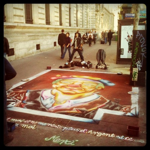Painting on the sidewalk. #paris #Placedelarépubique #street #art #clown (Taken with instagram)