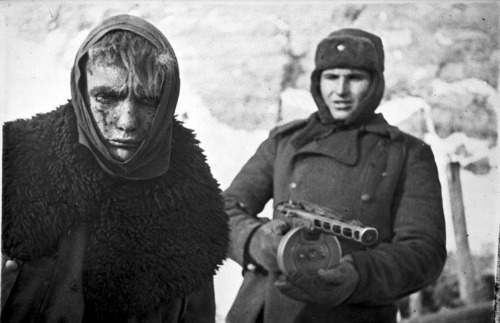 A Soviet soldier guarding a German POW following the Battle of Stalingrad. February, 1943.