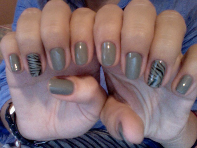 OPI's Suzi Takes the Wheel with some zebra stripes! This color is gray with a hint of green. So far, I love their fall collection. Every color I've used so far goes on so smoothy- I did this in the dark! (just not the stripes) Nails, grow faster please :(