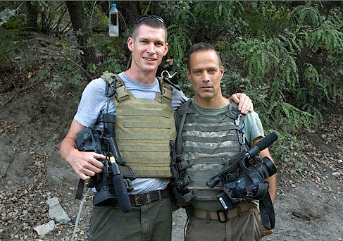kateoplis: Guardian's Q & A with Sebastian Junger    The Korengal Valley is said to be the deadliest place in Afghanistan. What was your first impression when you arrived? It looked like Colorado, like the American west. It was very beautiful. And I just thought what a great place to go camping or kayaking. If it wasn't Afghanistan, it would be a haven for outdoor adventure sports. You've said that you won't be returning to war reporting. Seeing what Tim's death did to me and my wife and others, a light bulb went on. I didn't want to be the cause of that pain to the people I'm closest to. I've done this for 20 years and there is a point you come to where you're repeating the same stunt. I'll continue reporting from overseas but if I find myself getting shot at – this is how I explained it to my wife – I will consider it embarrassing and a personal failure in a similar way to as if I had a car accident. What are you currently working on? I'm working on a film about Tim and I'm starting a medical training program for freelance journalists, a three-day training course in battlefield medicine. It will be three times a year in New York, London and Beirut. We're hoping to make the certification an industry norm in the next few years. Tim's wound didn't have to be mortal. He bled out but there are things you can do about that, but no one around him was equipped to do them and so he died.   Photo: Hetherington and Junger in Afghanistan, 2008. © Tim Hetherington