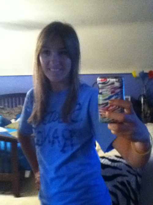 And me in my shirt:) kinda hard to tell, it says Starship Ranger. The back says starkid and Junior. My outfit will be complete with pink sunglasses:) Us starkids are takin ovaa the school tommoro! So pumped:)
