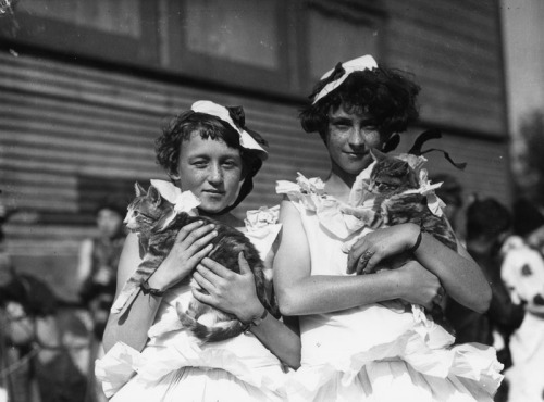 Two little girls with their cats at a pet show in Downtown Los Angeles, CA - 1930