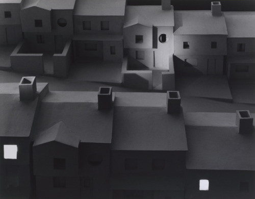 cavetocanvas:  Subdivision With Spotlight - James Casebere, 1982 From the Metropolitan Museum of Art:  Casebere's dramatically lit photographs of tabletop sculptures (made from plaster, Styrofoam, and cardboard) show uncannily familiar yet eerily inhuman spaces — from courtrooms and libraries to an empty storefront or a suburban street at night — that belong to everyone and no one, a ghost world of collective memory. Using the camera to question photography's cherished myths of documentary veracity and transparent objectivity, Casebere virtually invented the tradition of setup photography as it is practiced today.