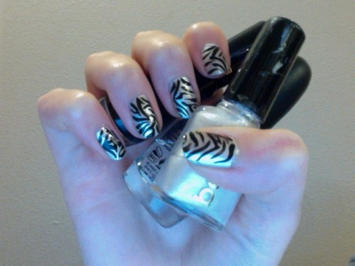 Zebra Nails! What You'll Need: Base coat Top Coat Silver or white nail polish Black nail polish with a precision brush Time: About 25 minutes Start With a base coat Wait for that to dry Next Paint two layers of white or silver polish (I used petites silver polish, you can buy it at Rite Aid for about 4 dollars) For the Stripes I found it very helpful to look up a picture of zebra print before starting The Z can be anywhere on your nail, and at any angleStart by making a wavy looking Z on your nail Then paint stripes on both sides of the Z Finish Let the stripes dry completely Add two coats of top coat For a more fun look you can try painting each nail a different color of the rainbow and then adding stripes!