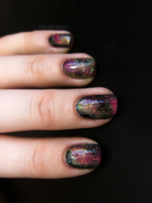eatmytimeaway:  chalkboardnails:  Day 19: Galaxy Nails China Glaze Liquid LeatherChina Glaze Happy Go LuckySinful Colors Dream OnZoya TanzyChina Glaze SkyscraperChina Glaze Fairy Dust  whaat