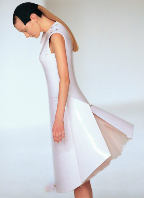 "Hussein Chalayan s/s 2000  The concept for this spring/summer 2000 collection focused on the relation between mankind, technology, and nature, and the designs in the collection represent those various forces. The ""Remote Control"" Dress was operated by a boy who came onto the catwalk with a remote control. His electronic instructions opened up the panels of the dress to reveal the soft tulle inside. The idea of directing living beings with a simple remote-control system was a lighthearted hint at the human tendency to want to control life as well as our sometimes exaggerated expectations of technology. -Hussein Chalayan"