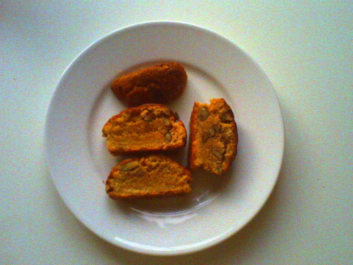 Peanut Butter Pecan Biscotti   4 tablespoons (1/2 stick) unsalted butter, softened   1/3 cup natural peanut butter   1 cup granulated sugar   1 large egg   1 large egg yolk (save the egg white for the egg wash)   2 cups all-purpose flour   1 teaspoon baking powder   1/4 teaspoon salt   1/2 cup pecans   egg wash and 1 tablespoon of milk for egg wash   sugar for topping    Place a rack in the center and upper third of the oven and preheat to 325 degrees F.  Line two baking sheets with parchment paper and set aside. In a medium bowl, whisk together flour, baking powder and salt.  Set aside. In the bowl of an electric stand mixer fit with a paddle attachment, beat together butter, peanut butter and sugar.  Beat until well incorporated and slightly fluffy in texture.  About 3 minutes. Stop the mixer, scrape down the bowl and add egg and egg yolk.  Beat on medium speed until well blended, about 2 minutes.  Add the dry ingredients, all at once to the peanut butter mixture and beat on low speed until just incorporated.  Stop mixer.  Add pecans and remove the bowl from the mixer.  Finish incorporating ingredients with a spatula.  Dough will be slightly dry. That's ok. Divide the batter between the two baking sheets and shape dough into two logs about 8-inches long and 1 1/2-inches wide.  Brush with egg wash and sprinkle generously with granulated sugar. Bake on alternating racks for 15 minutes.  Switch baking racks and  bake for another 15 to 20 minutes, until golden brown and cooked through.  Remove from the oven and allow to cool on the baking pans until cool enough to handle, but still soft.  Use a serrated knife to slice biscotti about 1-inch thick.  Place cut side down on the baking sheet and bake for another 10 to 15 minutes.  Remove from the oven and allow to cool. Biscotti will last, in an airtight container at room temperature, for up to 10 days. Recipe from Joy The Baker