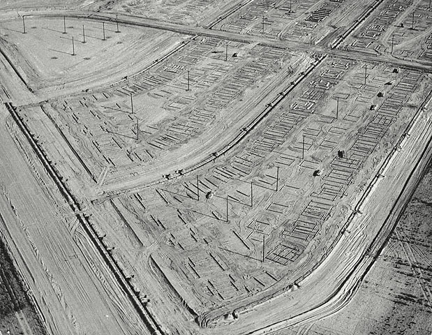 "The art: William Garnett, Trenching Lakewood, California, 1950. The news: ""Debunking the Cul-De-Sac,"" by Emily Badger for The Atlantic Cities. Note the similarity between Garnett's photograph and the Federal Housing Authority's graphic example of ""bad"" suburban development practice. As Badger notes in her piece, after about 1950, virtually no American developments were built with the pattern Garnett captures here.  The source: Collection of the J. Paul Getty Museum, Los Angeles. Nota bene: Today 3rd of May will feature five William Garnett 1950 photographs of the construction of what would become Lakewood, California. This is the second of those five posts. The first one is here. Garnett is one of America's most underrated photographers, a forerunner of the photographic movement known as the New Topographics, which documented the ways in which America was transforming the West — and America — through rapacious land-use policies. Garnett is best-known for his aerial photographs, pictures that adapted aerial military photography pioneered by Edward Steichen and others to examine post-war America. The from-above vantage point was later further popularized by Google Satellite."