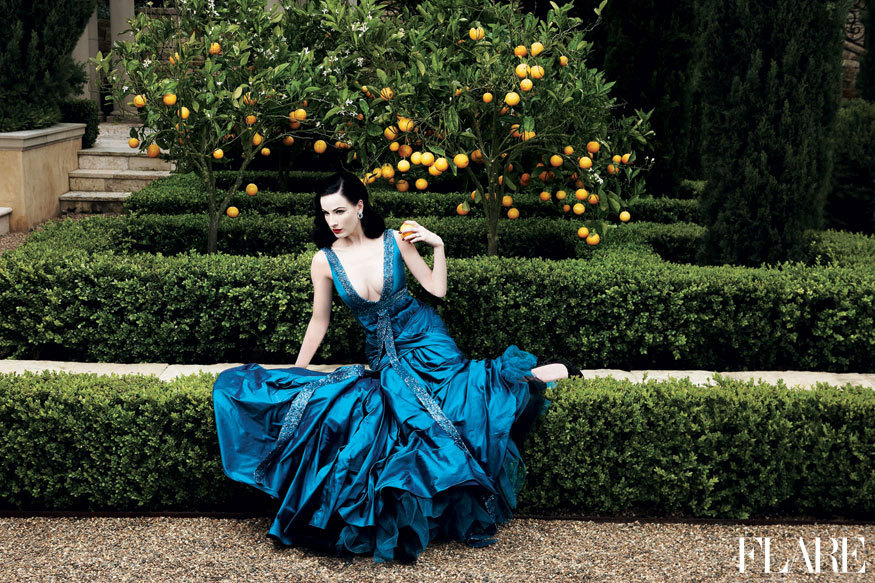 "Dita von Teese - November 2006 / Art Director: Tanya Watt / Photographer: Max Abadian  ""I've been a huge fan of Dita von Teese for years. We shot her cover story in the garden of a gorgeous mansion in Southern California. The photographer, Max Abadian, gave me a framed print of this stunning shot for Christmas last year. The colours – Dita's jet black hair and porcelain skin, the vivid turquoise Elie Saab gown, the garden's greenery and lemons – inspired the décor of my bedroom."" — Lisa Tant, Editor-in-Chief / Associate Publisher of FLARE Click here to see more fashion and celebrity moments from our archive."