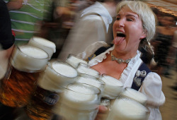 "theatlantic:  Oktoberfest 2011  On Saturday, the 178th Oktoberfest opened in Munich, Germany, with the traditional tapping of the first keg of beer by Munich's mayor, Christian Ude, shouting ""O'zapft is!"" (""It's tapped!""). The Bavarian festival takes place over 17 days, and some 6 million people are expected to attend. Last year, visitors drank more than 7 million one-liter mugs of beer. Attendance is free, but the beer will cost you: The price of a mug at any of the 14 tents this year comes to €9.20 ($12.60 U.S.). Gathered here are some of the scenes from Oktoberfest 2011's first weekend.  See more festive photographs at In Focus"