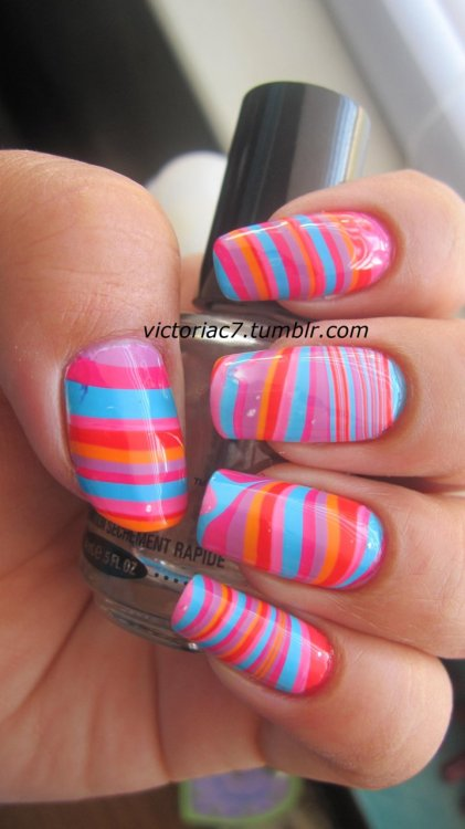 victoriac7:  Did a simple stripe design water marble.  I wanted to try out Zoya for water marbling (which worked fantastically btw), so for this one I used the Flash collection; it's extremely bright in person!  Colors used: Zoya - Robyn, Maura, Perrie, Dana, Jolene, Jancyn