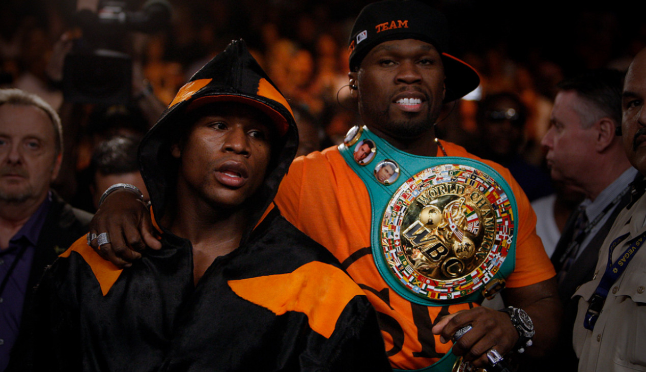 l18mbr:  Floyd Mayweather walking to the ring accompanied by 50 Cent.  even with all the shit both of them talk…they're fucking awesome.