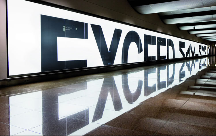 EXCEED MAXIMUM (via scene360) Billboard taking advantage of reflective floor to create simple message at Hamburg Airport. More here