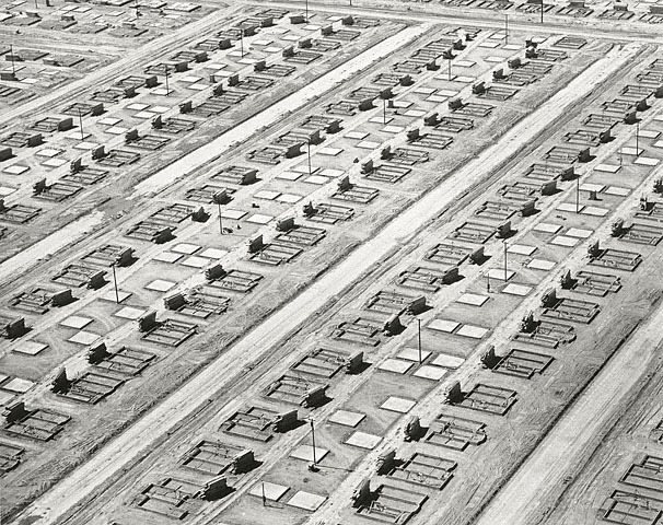 "The art: William Garnett, Foundations and Slabs, Lakewood, California, 1950. The news: ""Debunking the Cul-De-Sac,"" by Emily Badger for The Atlantic Cities. The source: Collection of the J. Paul Getty Museum, Los Angeles. Nota bene: Today 3rd of May will feature five William Garnett 1950 photographs of the construction of what would become Lakewood, California. This is the third of those five posts. The first one is here, the second, the third. Garnett is one of America's most underrated photographers, a forerunner of the photographic movement known as the New Topographics, which documented the ways in which America was transforming the West — and America — through rapacious land-use policies. Garnett is best-known for his aerial photographs, pictures that adapted aerial military photography pioneered by Edward Steichen and others to examine post-war America. The from-above vantage point was later further popularized by Google Satellite."