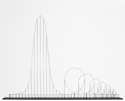 discoverynews:  Death by Roller Coaster This is a hypothetic euthanasia machine in the form of a roller coaster,  engineered to humanely – with elegance and euphoria – take the life of a  human being. Designer/Artist Julijonas Urbonas created the death coaster.  The 3-minute ride involves a long, slow, climb — nearly a third of a  mile long — that lifts one up to a height of more than 1600 feet,  followed by a massive fall and seven strategically sized and placed  loops. The final descent and series of loops take all of one minute. But  the 10g force from the spinning loops at 223 mph in that single minute  is lethal.  More