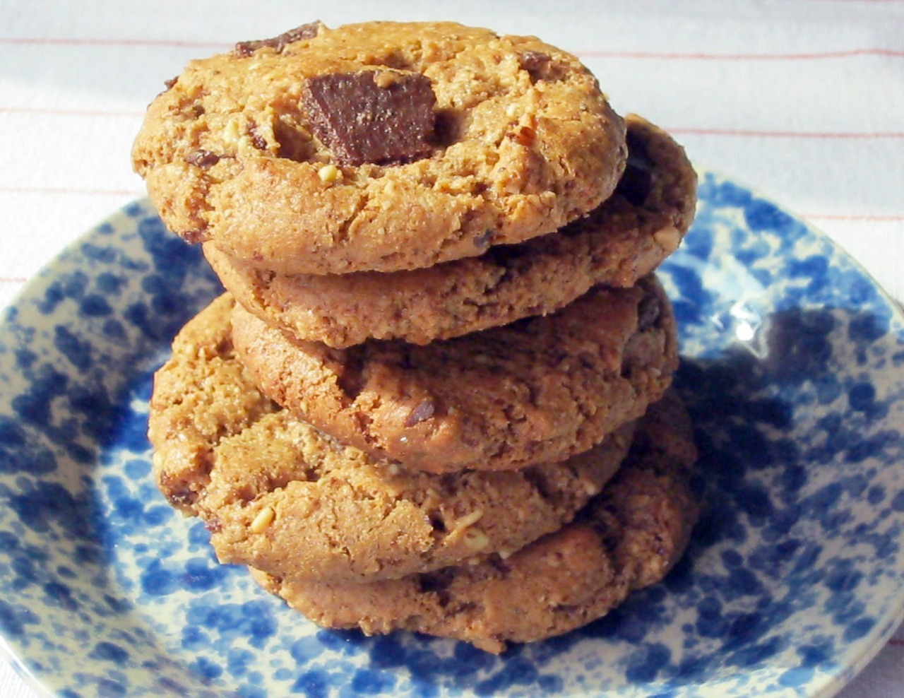 "robotheartrecipes:  Flourless Almond Butter Cookies with Mexican FlairMakes about 2 Dozen I have been majorly craving cookies lately, but with the end of summer heat wave we had been experiencing, baking was unappealing. Since temps dropped this weekend, I decided it was time to bust out the ol' cookie sheets. I wanted to make a cookie that would compliment the Mexican-influenced flavors of my meal so I decided to adapt one of my favorite cookies with some Mexican flair. I used piloncillo an unrefined sugar commonly used in Mexican baking. It comes in little compressed cones and tastes a lot like brown sugar mixed with molasses. I also incorporated Mexican chocolate, which is a sugary sweet chocolate laced with cinnamon. Mexican chocolate is readily available in many grocery stores—check the Hispanic or ethnic foods section. Piloncillo may be more challenging to find and might require a visit to a specialty store in some areas. These cookies turned out wonderful—we almost spoiled our dinner gobbling them down beforehand! INGREDIENTS 1 cup almond butter 3/4 grated or finely chopped piloncillo (or equal amount of brown sugar + 1 teaspoon molasses) 1 large egg, lightly beaten 1/2 teaspoon baking soda 1/4 teaspoon salt 1/2 teaspoon vanilla extract 3/4 cup chopped Mexican chocolate (such as Ibarra) INSTRUCTIONS Step One: Preheat oven to 350°F, with racks in upper and lower thirds. In a large bowl, stir together almond butter, piloncillo, egg, baking soda, salt, and vanilla until well combined. Stir in chopped chocolate. Step Two: With moistened hands, roll dough, about 1 heaping tablespoon at a time, into balls. Place 2 inches apart on two baking sheets. Step Three: Bake until cookies are golden and puffed, about 12 minutes, rotating sheets from top to bottom and front to back halfway through. Cool 5 minutes on sheets; transfer cookies to racks to cool completely. Source: Adapted from ""Flourless Peanut-Chocolate Cookies,"" from ""Everyday Food"" on PBS. View the original recipe on PBS.org."