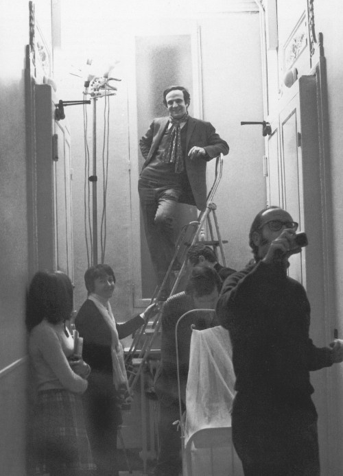 François Truffaut, Suzanne Schiffman, Claude Jade and Nestor Almendros in the apartment on the fourth floor, above the offices of Les Films du Carrosse, where the scenes of Antoine and Christine's married life in Bed and Board were filmed. 1970.