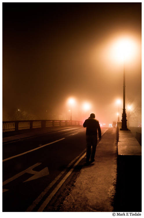tismark:  Galway streets in the fog! The first several days I was in Galway, there was fog, fog that grew thicker as each day passed. This night was the denouement of the fog. It was a truly surreal experience walking in the fog never mind taking photos in it! About: Website / Photography Site / Travels / Twitter