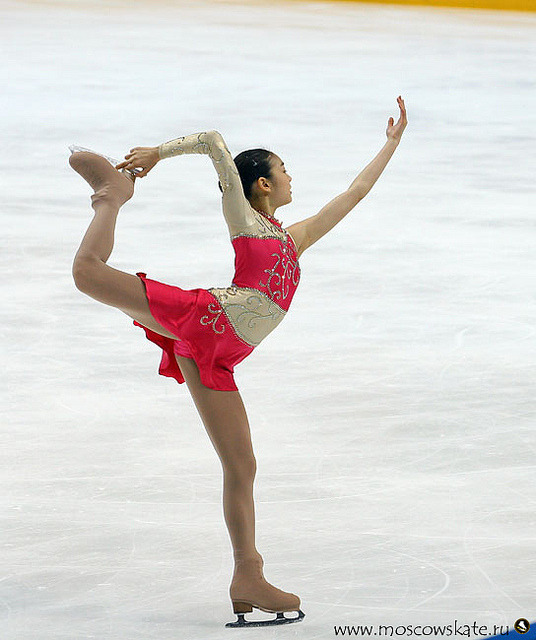 runintomyreality:  Figure Skating Queen YUNA KIM by { QUEEN YUNA } on Flickr. I can do this but not on the ice yet. I have my leg straight out behind me and higher than my waist. (: