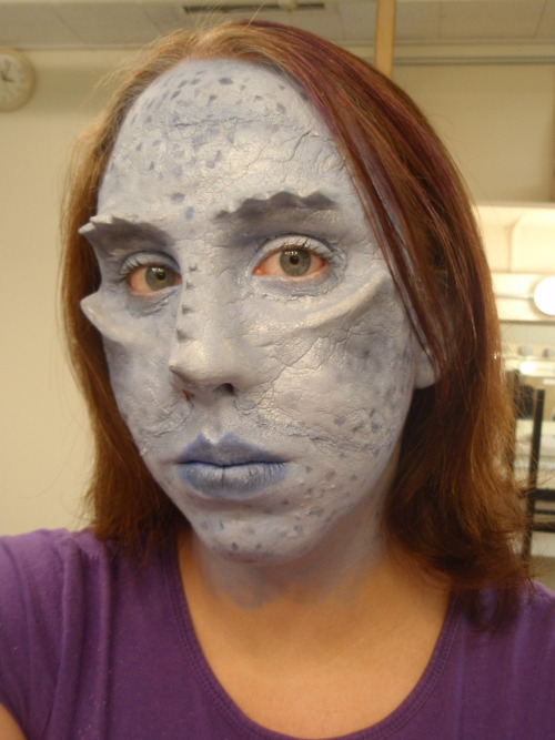 cassluvsyou:  This was my advanced makeup final for the end of last semester. it incorporates airbrush, foam latex prosthetic, and creme makeup. The piece was sculpted by me. It's inspired by/supposed to be a blue half-dragon from Dungeons and Dragons (more human then dragon though). Just figured I'd share this with you all. Cause I can. (The edges are kind of awful, but it was my first experience applying a latex prosthetic and I had to do it to myself.)  this is insane.
