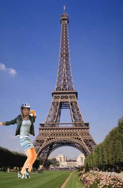 Hil Duff wears a helmet while visiting the Eiffel Tower.