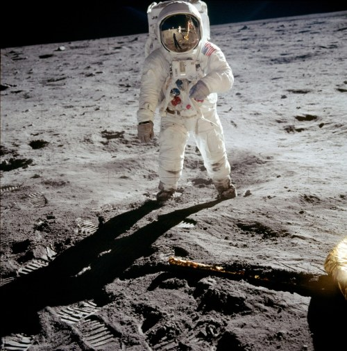 "picturethisdate:  On July 21, 1969, Neil Armstrong and Buzz Aldrin became the first humans to set foot on the moon. Above, one of the most famous Apollo 11 photographs shows Aldrin on the surface of the Moon with Armstrong reflected in his visor.  I was seven years old, sitting on my dad's lap and Walter Cronkite was reporting. I started babbling about some sort of nonsense when dad whispered in my ear, ""Listen and watch, Punkin. This is history."" I'm 50. I still remember this and when minutes after this touch of the moon dad and mom took me outside where it was a full moon. I felt like I could touch it. ~Jayne d'Arcy"