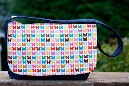 (via Zaaberry: Kid's Messenger Bag Tutorial)  I'd use this for a lunchbag.