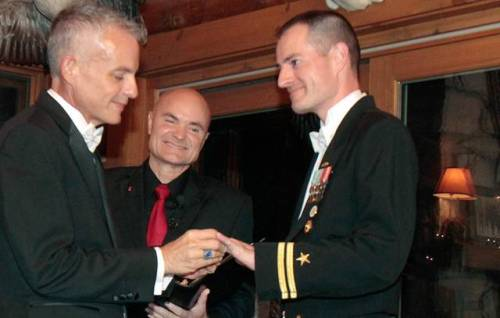 "When Navy Lt. Gary Ross and his partner were able to recite their vows before family and friends at the first possible moment after the formal repeal of the military's ""don't ask, don't tell"" policy. Just after midnight Tuesday, the partners of 11 years were married. Don't ask, don't tell,"" the military ban on openly gay service members, has officially ended. Read more about Navy Lt. Ross and the repeal here."