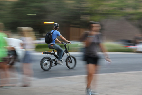 Panning on Flickr.more for photography class! i love how the foreground AND background are blurry, but that dude is in focus
