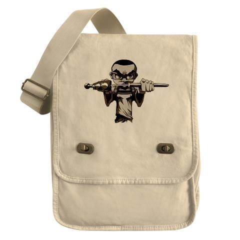 Logik Sword.  Carry your stuff in style with this dyed 100% canvas field bag. Great  for computers or iPads, this cool canvas bag is enzyme washed for a  vintage look. Each features a handy cotton-webbed shoulder strap, front  flap with antique brass buckles & inside hanging zippered pocket.