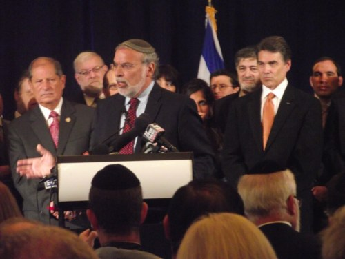 Dov Hikind, a Democratic Assemblyman, speaking at Republican Rick Perry's press conference in Manhattan today. Republican Rep. Bob Turner is in the background.