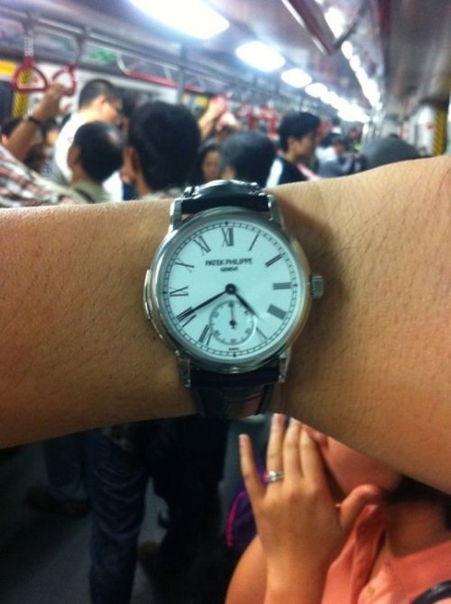 watchs:  Public transportation is the only option when you've spent all your money on a seemingly ordinary dress watch that in reality costs $375,000.00.