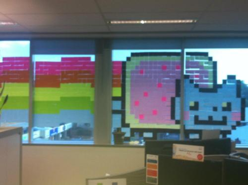 meekaio:  thedailywhat:  Post-It Mural of the Day: Pro: It looks amazing. Con: Everyone in the office will be humming the Nyan Cat theme song incessantly until this thing comes down. [reddit.]  OMMMGGGG <333333